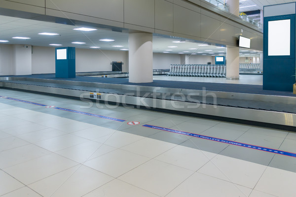 empty conveyor belt for carrying the passenger luggage or baggag Stock photo © FrameAngel
