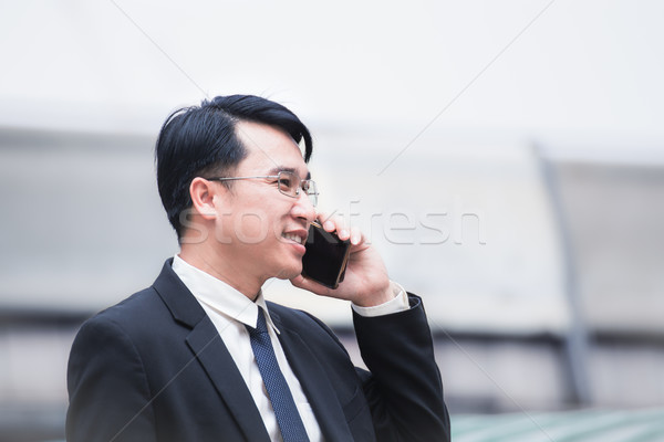 businessman using a cell phone and modern office building backgr Stock photo © FrameAngel