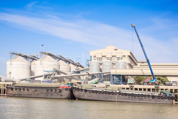 crane load goods into containner ship Stock photo © FrameAngel