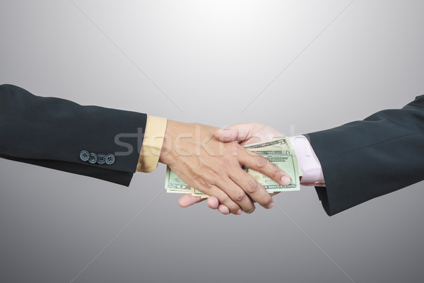 businessman hand and money to other for corruption concept Stock photo © FrameAngel