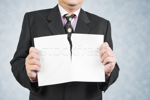 Stock photo: Businessman tearing sheet white paper on white background