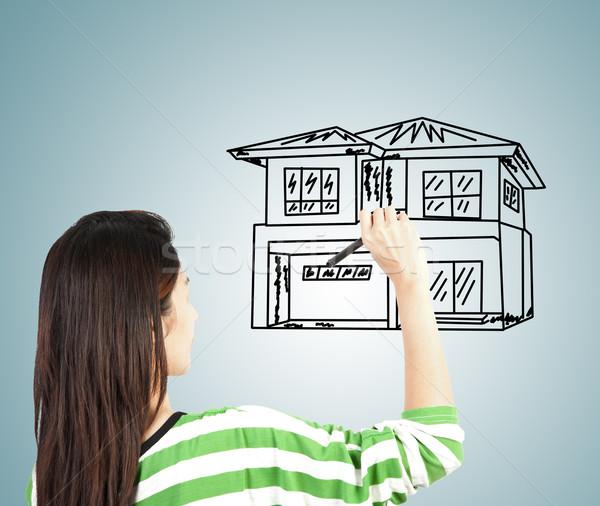 Mujer elaborar casa hierba edificio pluma Foto stock © FrameAngel