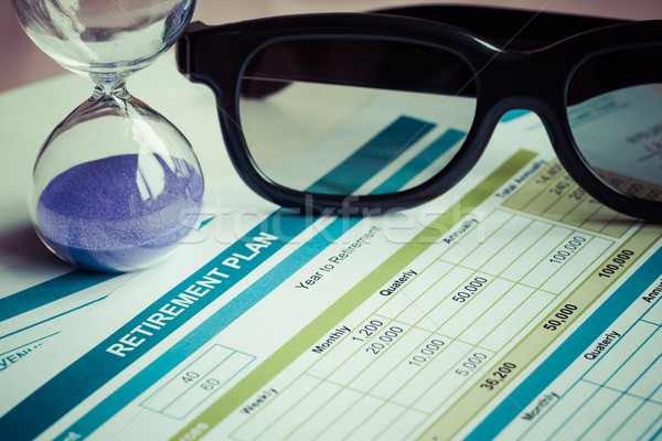 Retirement Planning with glasses and hourglass, business concept Stock photo © FrameAngel