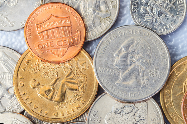Group of US American coins and one cent on top Stock photo © FrameAngel