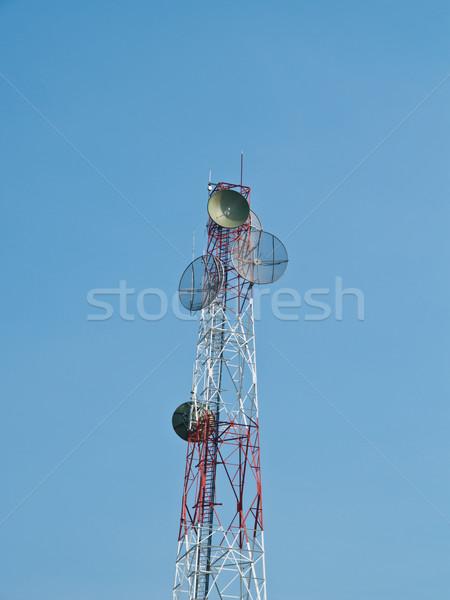 Satellite disc against blue sky Stock photo © FrameAngel