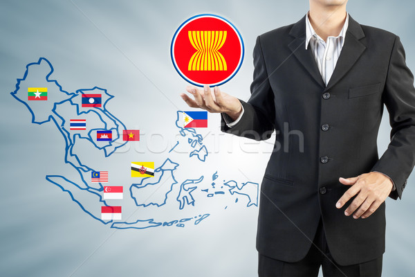 ASEAN Economic Community in businessman hand  Stock photo © FrameAngel