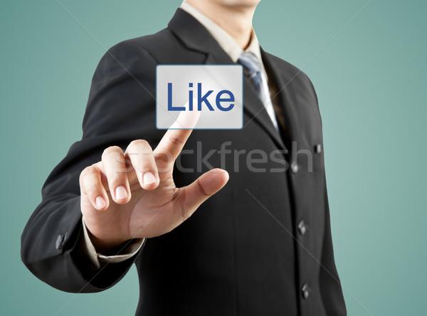Biznesmen strony popychanie jak przycisk działalności Zdjęcia stock © FrameAngel