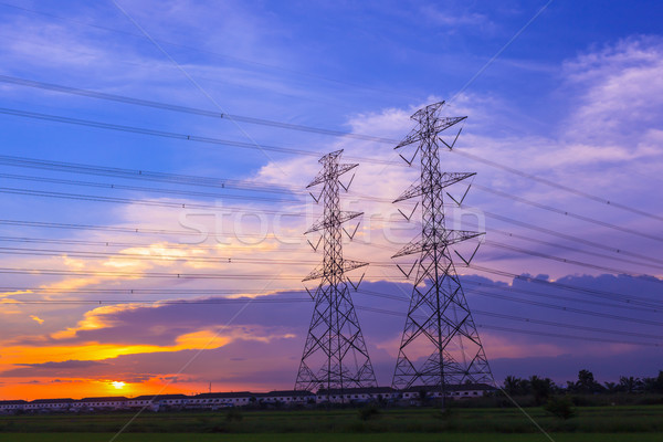 high voltage post tower and power line on sunset sky background Stock photo © FrameAngel