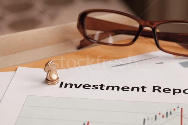 Investment Report letter document and eyeglass; document is mock Stock photo © FrameAngel
