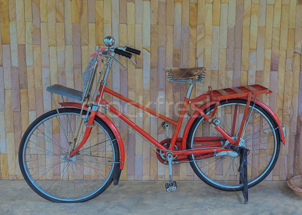 Vintage old bicycle on wall Stock photo © FrameAngel