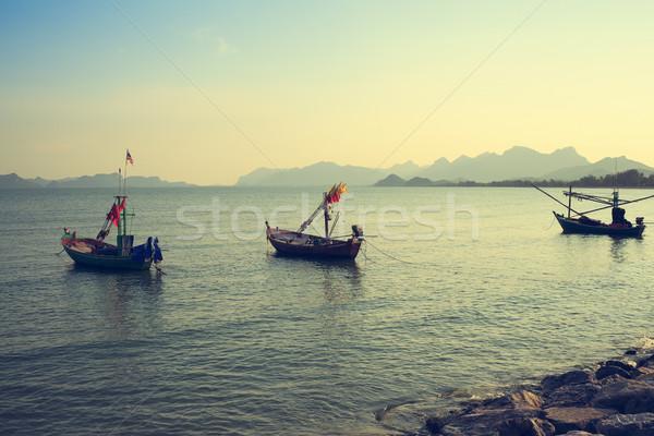 Vintage group of fishing boat anchored at Pranburi beach in Thai Stock photo © FrameAngel