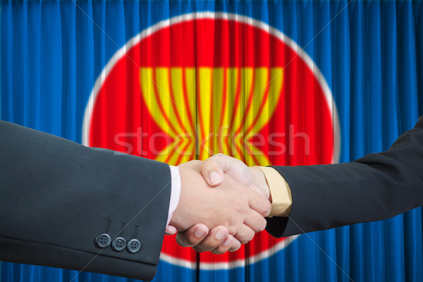 ASEAN Economic Community in businessman handshake Stock photo © FrameAngel