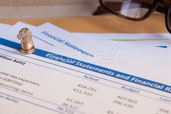 Financial statement letter on brown envelope and eyeglass, busin Stock photo © FrameAngel