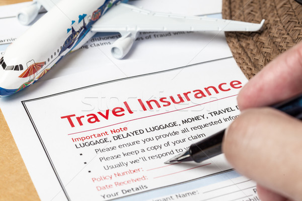 Travel Insurance Claim application form and hat with eyeglass an Stock photo © FrameAngel