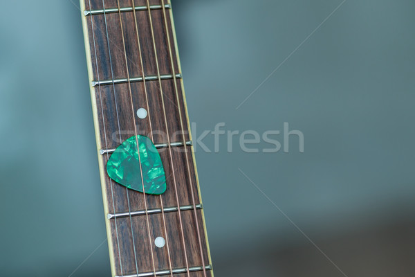 colorful green guitar pick on finger board, as abstract backgrou Stock photo © FrameAngel