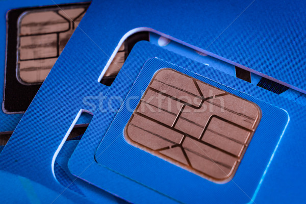 sim card used of mobile smart phone close up macro shot on blue  Stock photo © FrameAngel