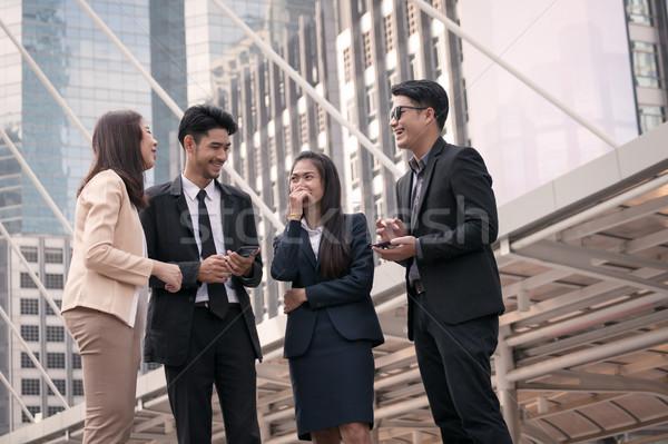 бизнесменов женщины группа счастливым современных Сток-фото © FrameAngel