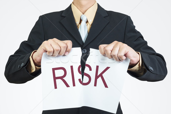 Businessman tearing sheet paper, risk management concept Stock photo © FrameAngel