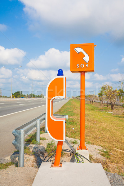 SOS sign and phone box on highway, road safety Stock photo © FrameAngel