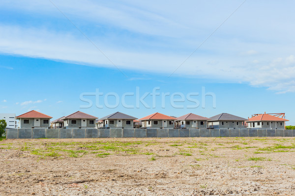 House Building and Construction Site village in progress, waitin Stock photo © FrameAngel