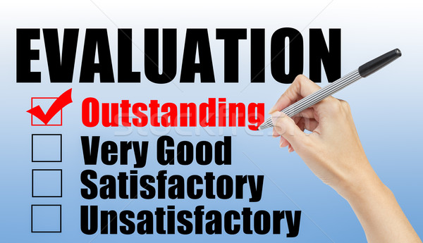 Evaluation form and hand check outstanding Stock photo © FrameAngel