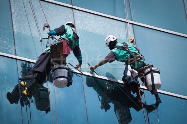 group of workers cleaning windows service on high rise building Stock photo © FrameAngel