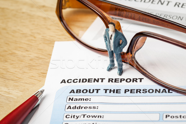 Accident report application form and businessman with pen and ey Stock photo © FrameAngel