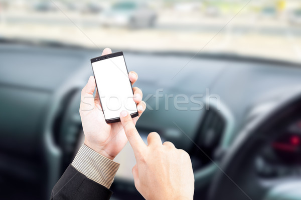 Hand holding smart phone text message in car blur background roa Stock photo © FrameAngel