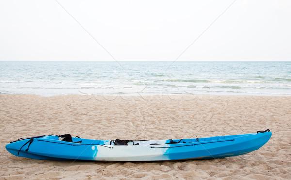 Colourful kayak on the beach Stock photo © FrameAngel