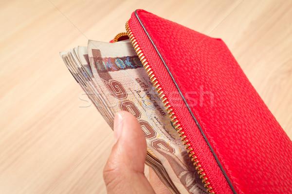 Mão vermelho couro carteira thai Foto stock © FrameAngel