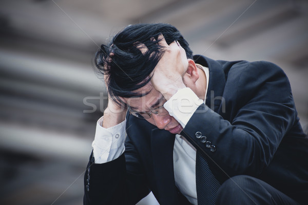 asian businessman sad worry tired and headache, stress at workpl Stock photo © FrameAngel