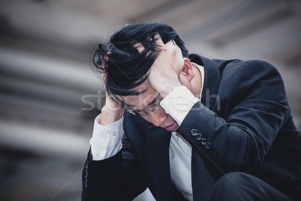 Asya işadamı üzücü endişe yorgun baş ağrısı Stok fotoğraf © FrameAngel