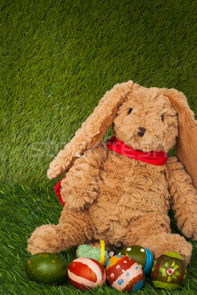 Rabbit, sit on green grass with group of colorful eggs, can use  Stock photo © FrameAngel