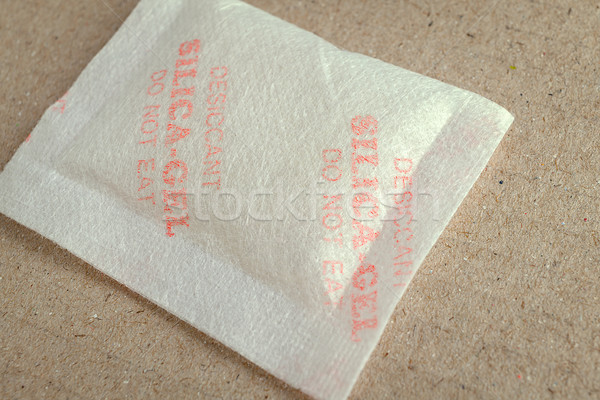 Close up silica gel or desiccant in paper bag background Stock photo © FrameAngel