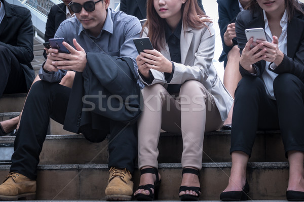 group of business man and woman happy sitting and using a cell p Stock photo © FrameAngel