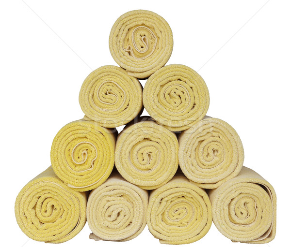 Rolled up spa towels on white Stock photo © FrameAngel