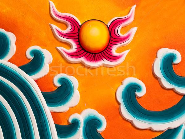 Sun sculpture on wall  Stock photo © FrameAngel