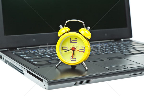 Clock on Notebook as time management concept Stock photo © FrameAngel