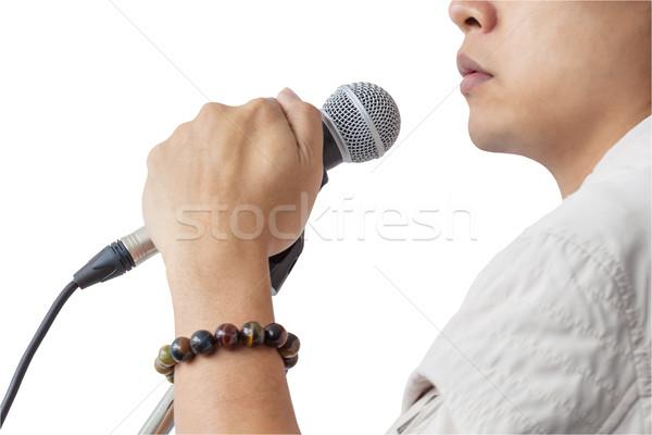 Férfi kéz tart mikrofon áll énekel Stock fotó © FrameAngel