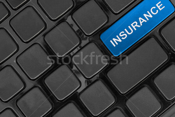 keyboard close up,top view, insurance  word Stock photo © FrameAngel
