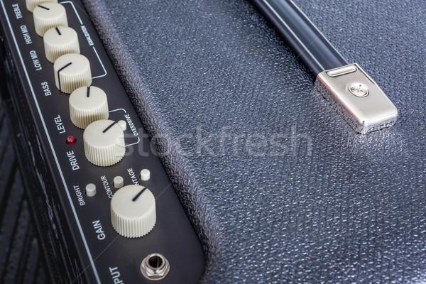 Button of Guitar Power Amplifier, closeup view background Stock photo © FrameAngel