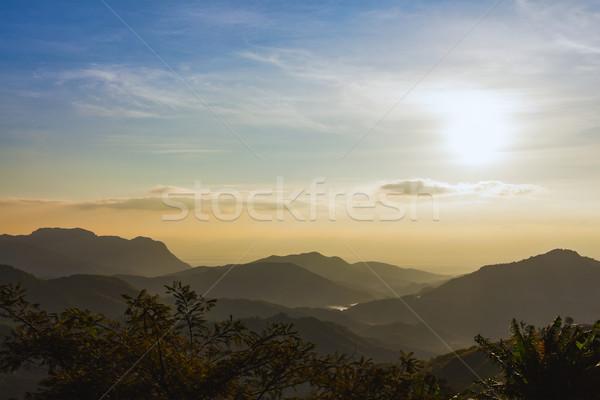 sunrise over mountains under mist in the morning at Khao Kho Nat Stock photo © FrameAngel