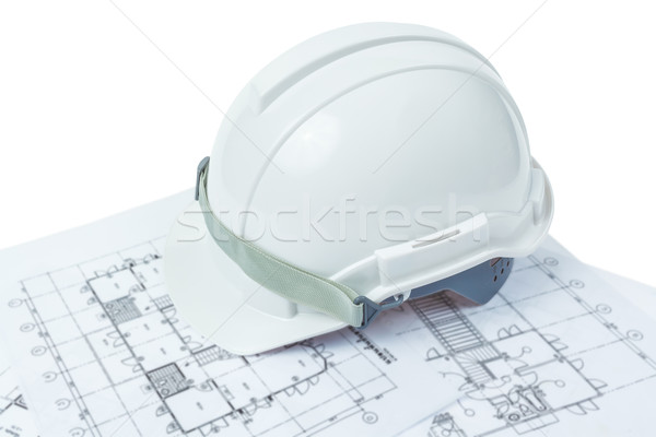 engineering concept, safety helmet with working plan Stock photo © FrameAngel
