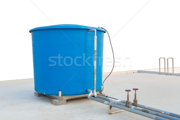 Blue water tank of industrial building on roof top on white back Stock photo © FrameAngel