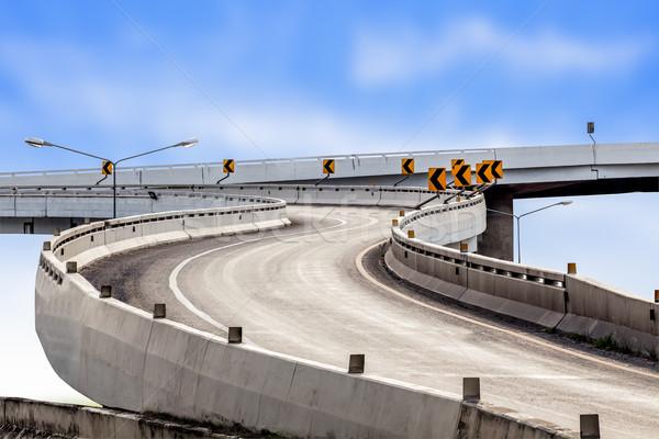 Highway asphalt road curve and traffic sign with blue sky backgr Stock photo © FrameAngel