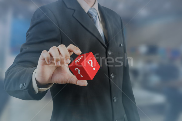 businessman hand and hold red cubic with question mark Stock photo © FrameAngel