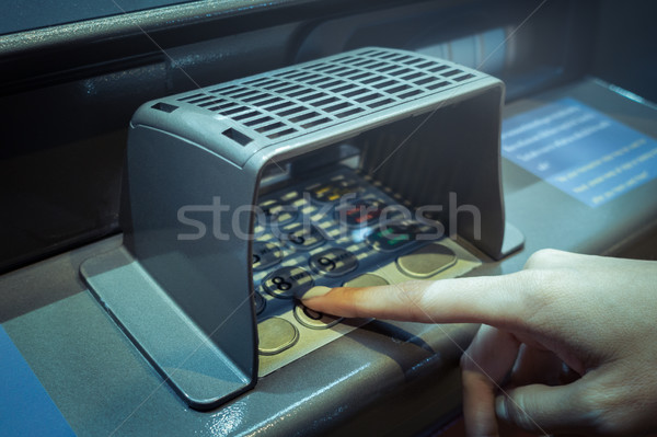 finger point at A.T.M. numpad keypad with guard for protect and  Stock photo © FrameAngel