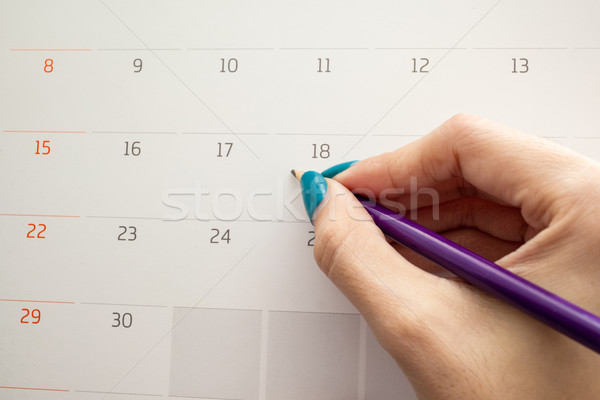 hand holding pencil on calendar for  making appointment  importa Stock photo © FrameAngel