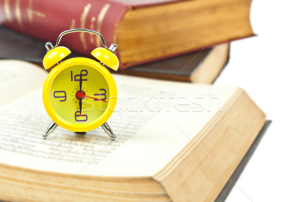 Clock and book as time management concept Stock photo © FrameAngel