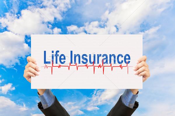 Imprenditore assicurazione sulla vita cielo blu business carta Foto d'archivio © FrameAngel